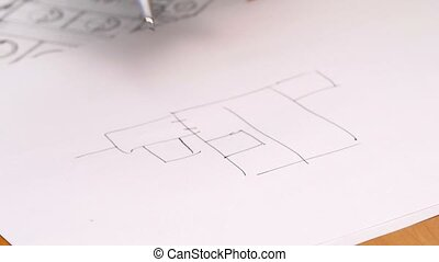 Person's Hand Drawing Plan On Blue Print. Close-up.