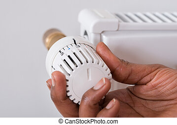 Person's Hand Holding Radiator Thermostat - Close-up Of...