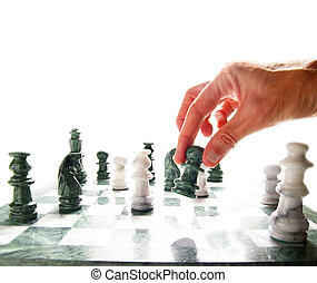 person\'s hand moving a chess piece, on white