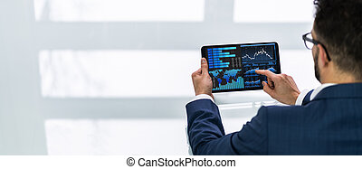 Hand Pointing On Graph At Tablet