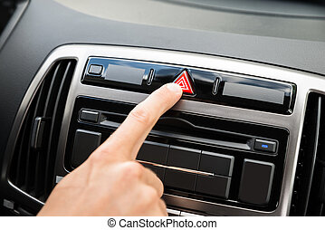 Person's Hand Pressing Emergency Button