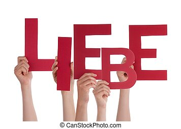 Persons Holding Liebe - Many Persons Holding the German Word...