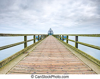 Perspective view of a wooden pier on the ocean. Vintage wooden pier
