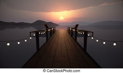 Perspective view of a wooden pier on the pond at sunset