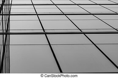 Perspective view of modern futuristic glass building abstract background. Exterior of office glass building architecture. Reflection in transparent glass of business building. Company glass window.