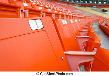 perspective view of orange seats in rows