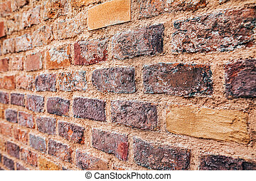 Perspective view of red grunge brick wall