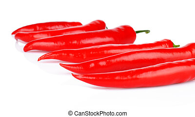 Perspective view of red peppers isolated white background