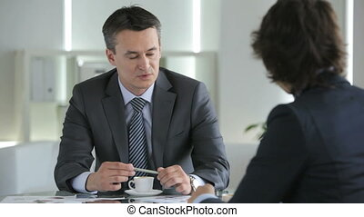 Persuasion - Serious businessman looking confidently and...