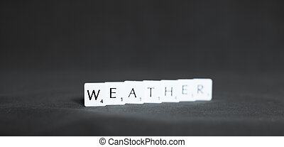 Perth, Scotland - 25 January 2020: word Weather made out of scrabble letter blocks