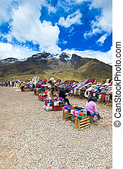PERU - SEPTEMBER 6, 2015: Unidentified women selling the traditional local textile items on the La Raya Pass near Sicuani, Perucal textile items on the La Raya Pass near Sicuani, Peru