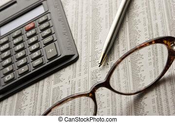 Perusing Stocks - Paper, glasses, pen, and calculator, items...