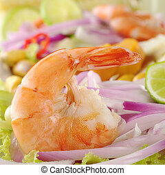 Peruvian Prawn Ceviche: King prawn on red onions and lettuce with lime slices (Selective Focus, Focus on the prawn)