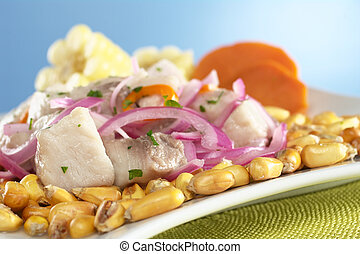 Peruvian-style ceviche made out of raw mahi-mahi fish (Spanish: perico), red onions and aji (Peruvian hot pepper) and served with roasted corn (cancha) and cooked corn cob as well as cooked sweet pota