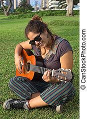 Peruvian Woman Playing the Guitar