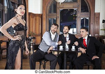Pervert Men Looking At Tango Dancer In Restaurant