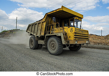 BelAZ truck transports ore mined in the quarry