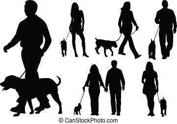 pessoas andando, cachorros