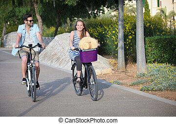 pessoas, montando, aluguel, ou, contratar, bicicletas