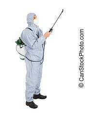 Pest Control Worker In Protective Workwear And Mask Spraying Pesticides Over White Background