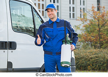 Pest Control Worker Showing Thumbsup By Truck - Portrait of...