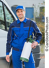 Pest Control Worker With Pesticide Against Truck - Portrait...