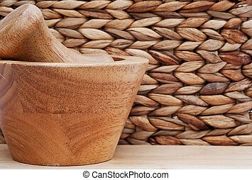 Pestle and mortar with basketweave background