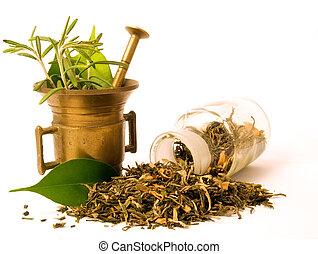 Pestle, herbs and pharmacy bottle.