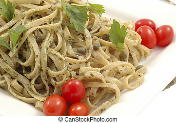 Tasty pesto linguine with capers and tomatoes.