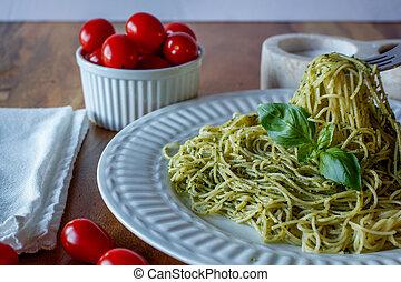 pesto pasta in a white bowl