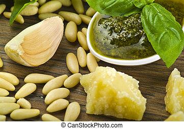 Pesto sauce over White spoon whit fresh ingredients