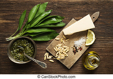 Wild garlic pesto ingredients on wooden background