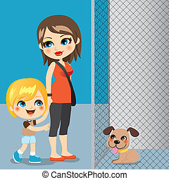 Pet Adoption - Little boy with mother adopting a cute dog ...