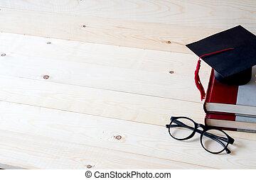 pet, boekjes , afgestudeerd, boven