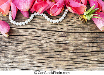 petals of red roses on a wooden background