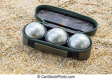 petanque ball set in the bag on the field with nobody.