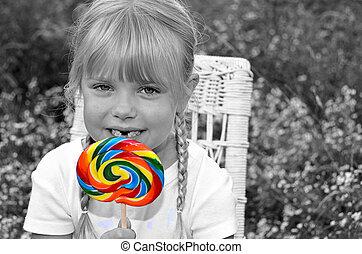 petite fille, à, coloré, sucette