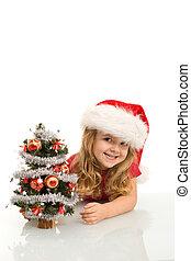 petite fille, arbre, jeter coup oeil, petit, sourire, noël, dehors