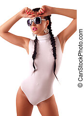 petite woman with a white skin-tight costume