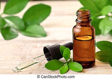 Petitgrain essential oil on the wooden board