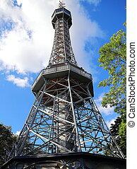 Petrin tower in Prague in Czech Republic on summer blue sky