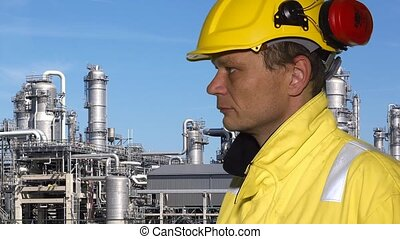 Petrochemical engineer - Person wearing safety clothing,...