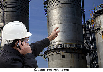 petrochemical plant engineer - engineer calling and pointing...
