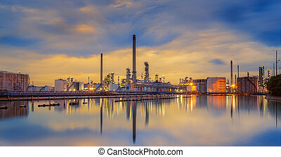 petrochemical plant in night time with reflection over the...