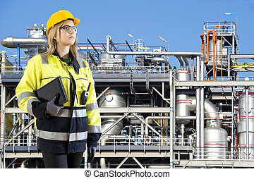 Petrochemical plant operator - Woman, posing with a tablet...