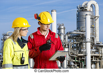 Petrochemical safety officers - Two engineers going through...