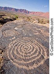 Petroglyphs carved onto rock surface by prehistoric Native American(s) at Anasazi Canyon, Utah, USA.