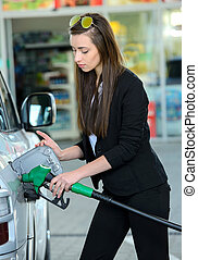 Petrol filling station - Business woman on filling station,...