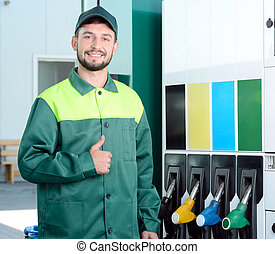 Petrol filling station - Smiling worker at the gas station,...