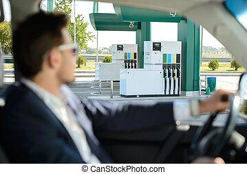 Petrol filling station - Man in his car stops at petrol...